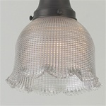 A beautiful rounded bell prismatic shade with scalloped edges. A vintage original.