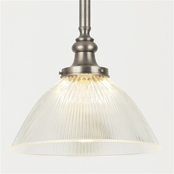 A vintage Holophane light fixture with original metal fittings